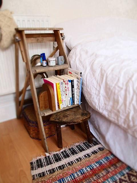 a little wooden ladder and stool for storing all the stuff you may need