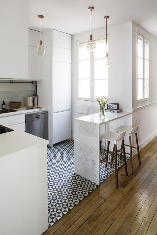 a small waterfall countertop can be used for breakfast, add tall stools and voila