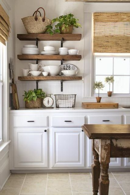 thick open shelves and dinnerware makes the kitchen look more cluttered
