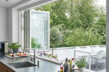 20 a folding window can be a nice idea to connect the kitchen to outdoors and easily serve food outdoors