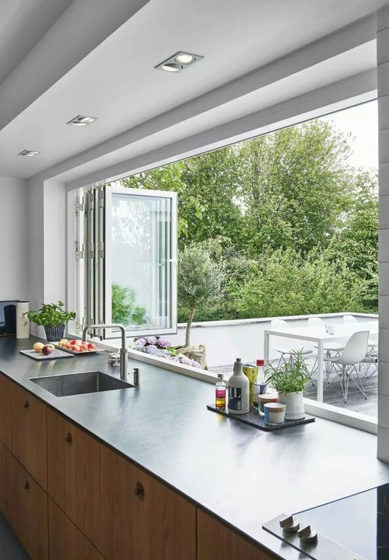 a folding window can be a nice idea to connect the kitchen to outdoors and easily serve food outdoors