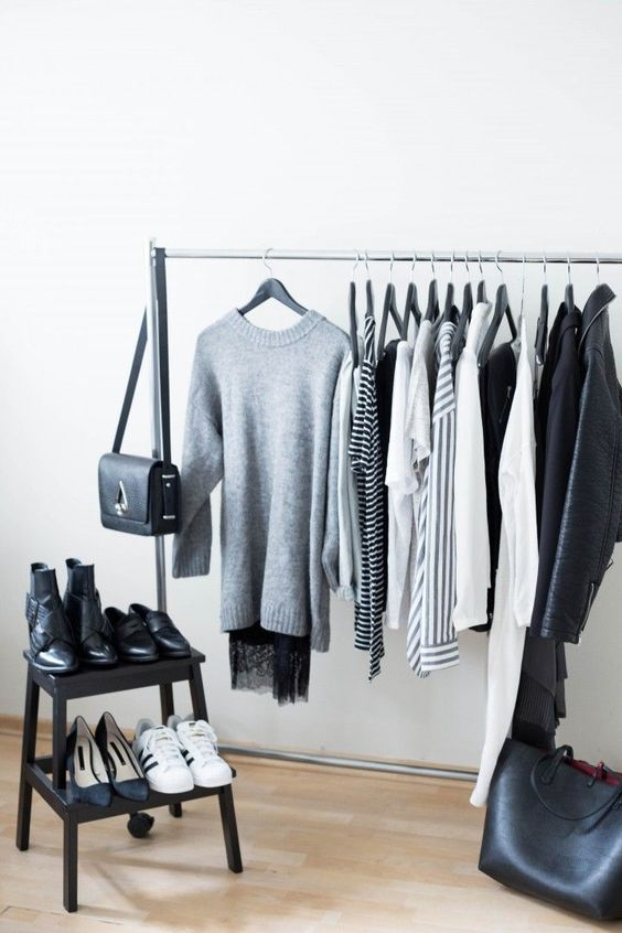 a minimalist rack for clothes and a small step shelf for shoes helps to see everything you have at once