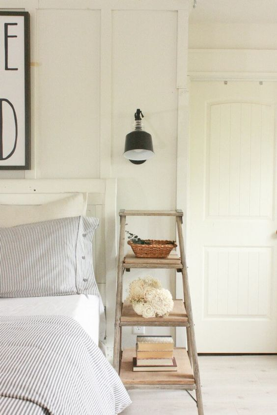 a shabby chic ladder is a nice nightstand that doesn't take much space and features open storage