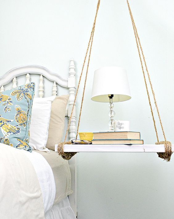 a simple and cute hanging bedside table painted wood and twine for a rustic touch