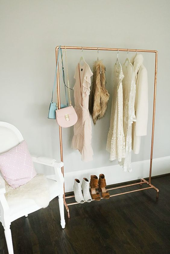 a chic lightweight copper pipe rack with a shelf for shoes is perfect for a girls' room
