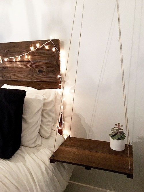 a simple hanging bedside table of some yarn and a plywood piece for a Scnadinavian space