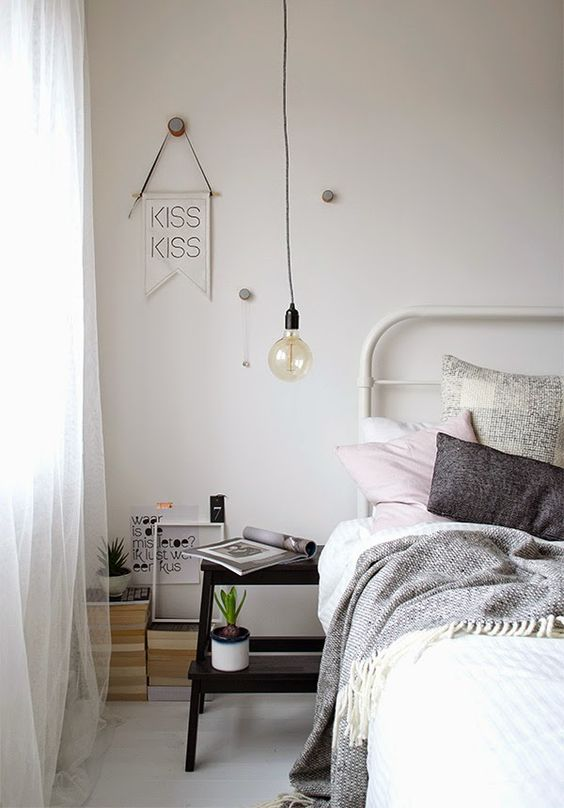 a small black ladder can be a nice nightstand idea for a Scandinavian bedroom