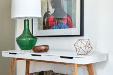 21 a super colorful artwork, a bright upholstered ottoman and a green lamp for summer