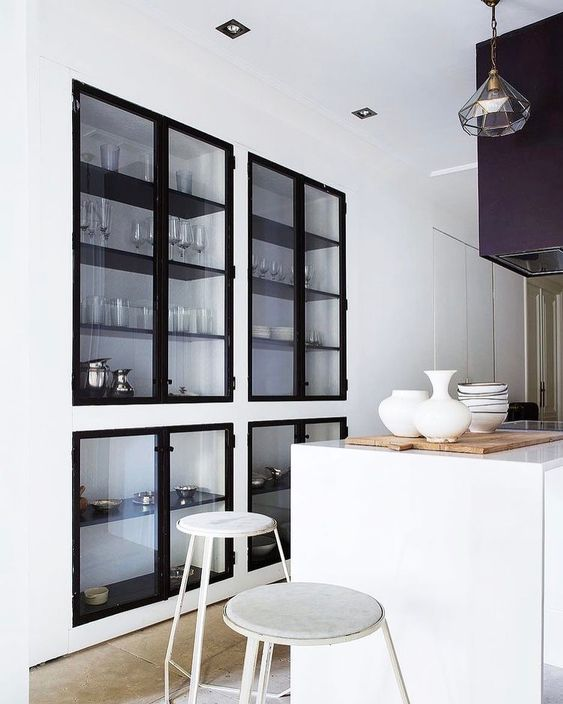 even built-in cabinets with glass doors make your space less cluttered and cozier