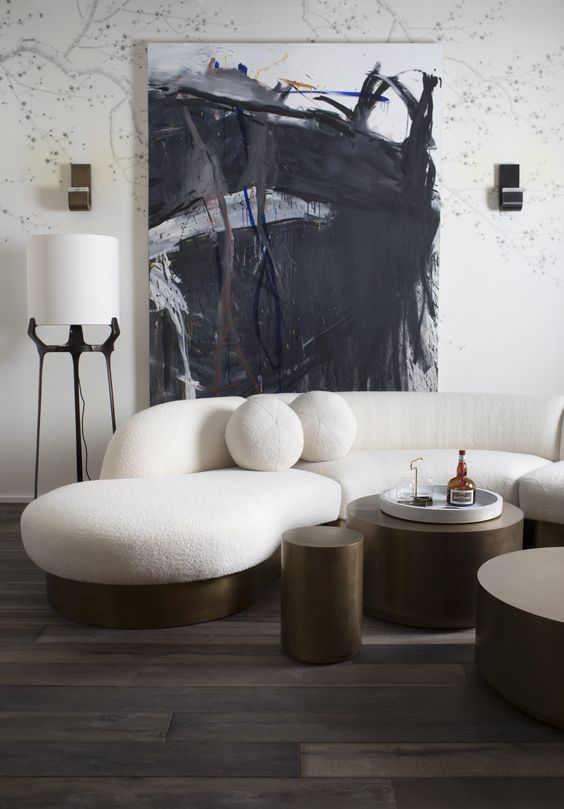 with such a rounded sculptural sofa on a metal base your room will be striking