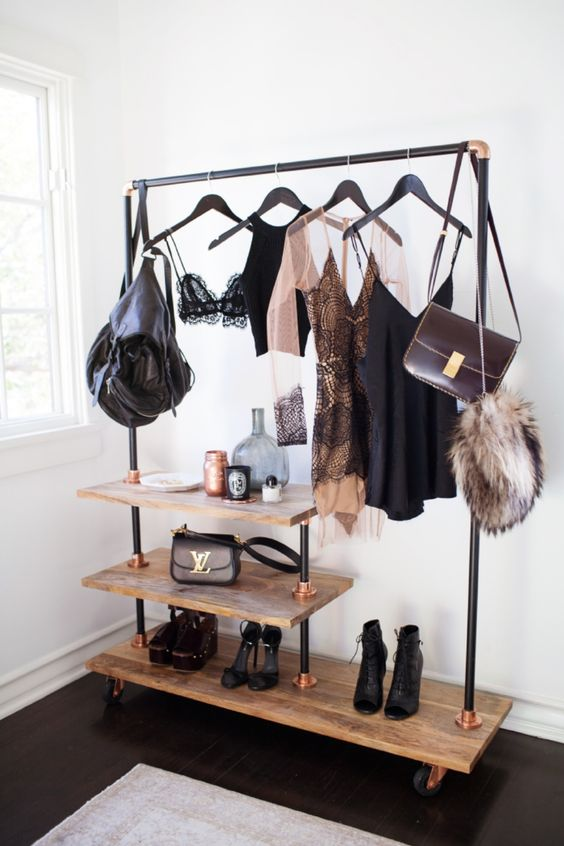 a cool plywood, black pipe and copper details rack will display everything you have the best way possible