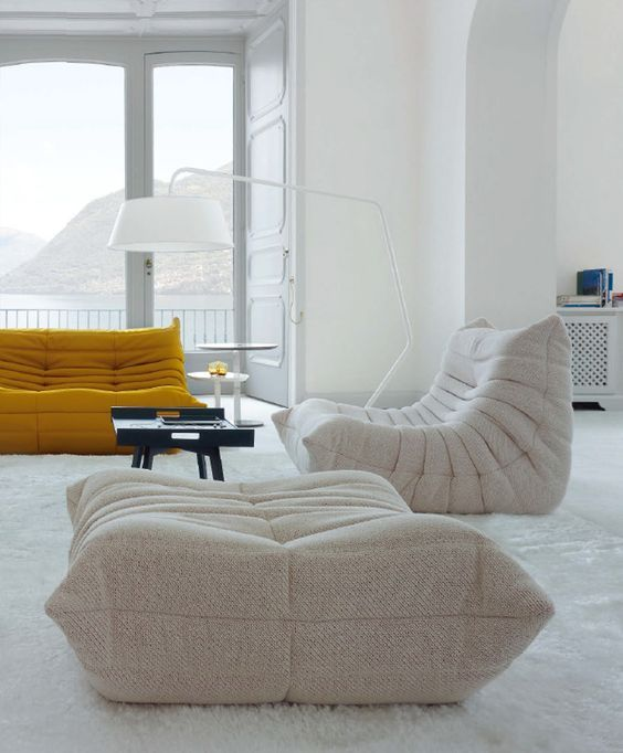 a creative modern off-white loveseat and a matching mustard one for a bold contemporary space