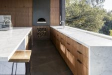 22 a large window acts as a backsplash too and the views are amazing, the space looks vaster
