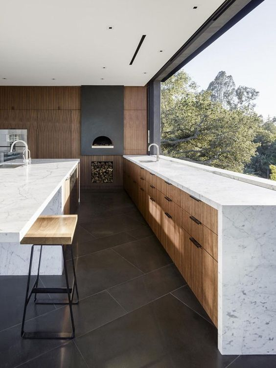 a large window acts as a backsplash too and the views are amazing, the space looks vaster