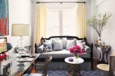 22 a whimsy guest bedroom with a sleeping space and a glass desk that looks airy and ethereal