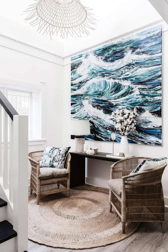 an oversized seaside artwork takes over this small space and makes it wow