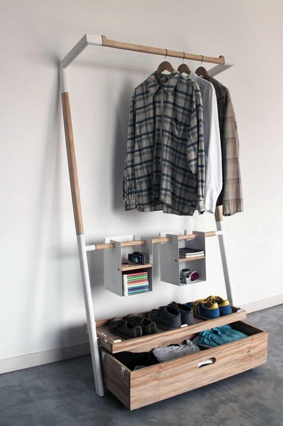 a functional modern makeshift closet with a drawer for smaller stuff and some hanging open boxes for accessories