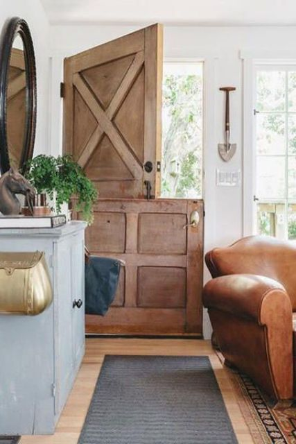 a rustic stained wooden door with no glass adds to the rustic living room
