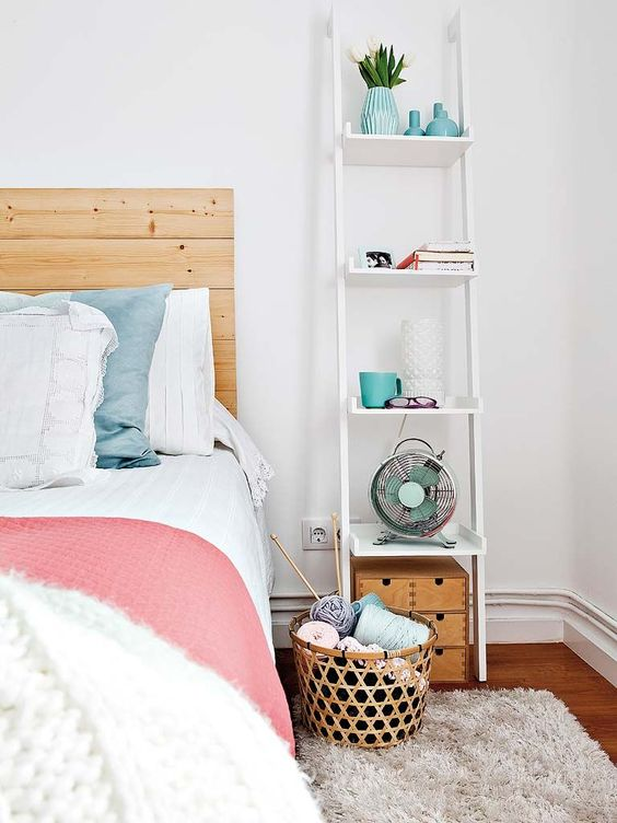 a tall ladder nightstand for much open storage and a tiny trunk under it