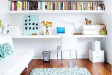 24 an airy and bright space with built-in shelves and a desk plus a small sofa to turn into a bed