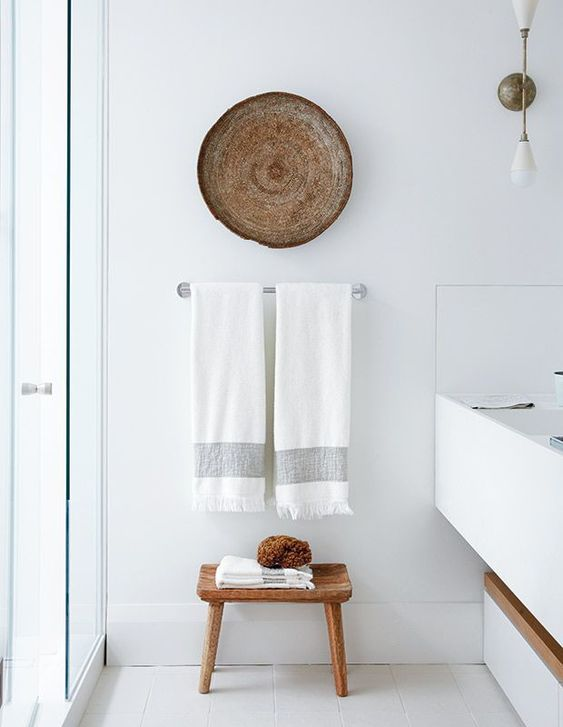 place a wooden stool and hang a basket, and a boring white space will look better