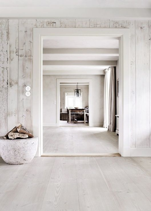 whitewashed wood walls and floors make the spaces airy and light-filled