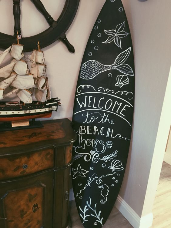 DIY chalk surfboard is a unique and modern artwork idea for a beach home
