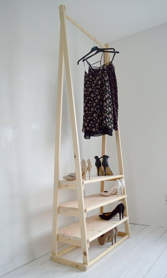 a light-colored wooden rack for clothes and step shelves for shoes can be handmade