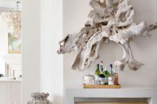26 a large whitewashed piece of driftwood is a unique wall art idea for a coastal home