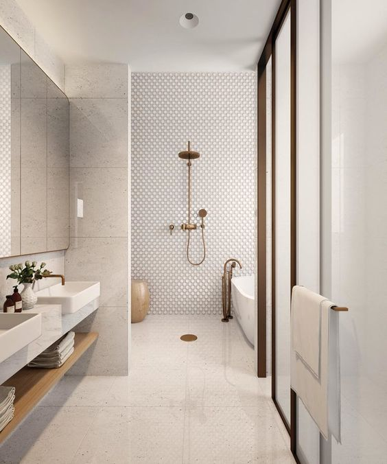all-neutral yet textural tiles on the walls and floor for a bright and interesting look