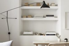 26 place a convertible sofa and a small lightweight desk plus built-in shelves to save much space