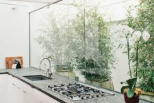 26 skylights and a large window fill the kitchen with light and make it feel like outdoors