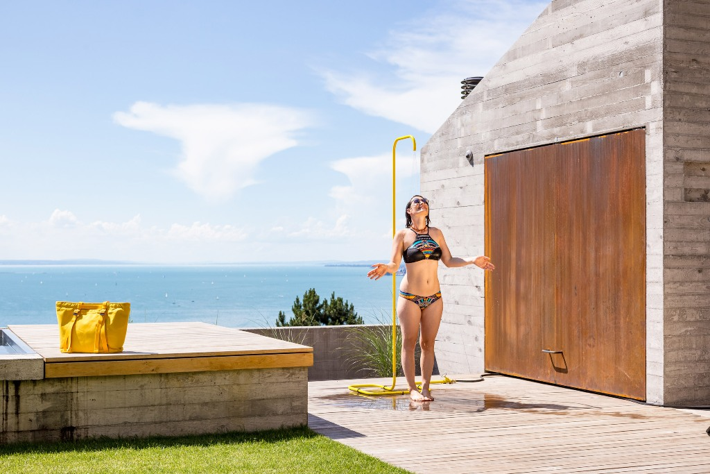 This minimalist outdoor shower is right what you need for your space with its bold design
