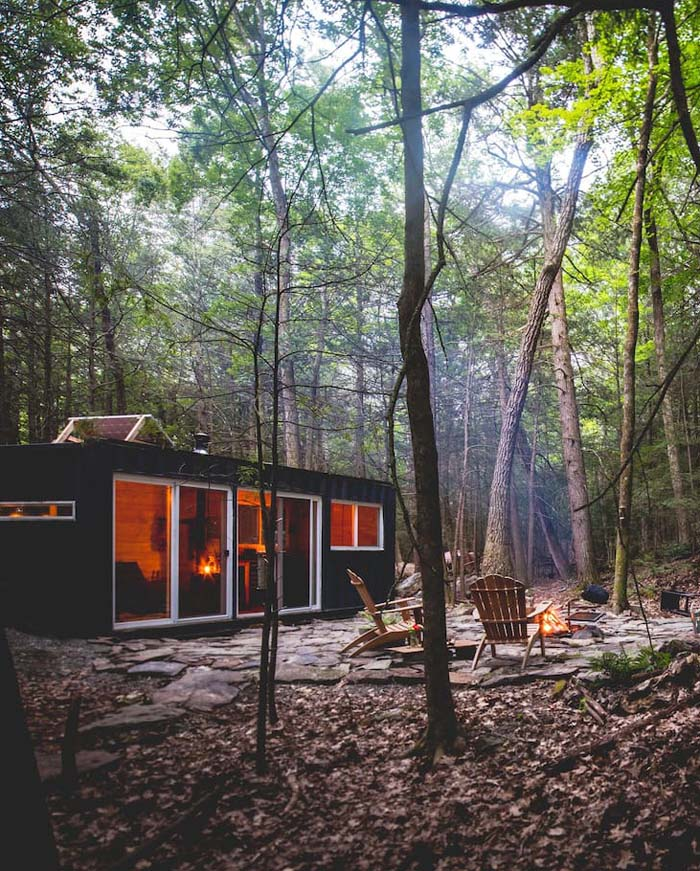 This small forest cabin is made of a shipping container and features everything necessary for a nice rest