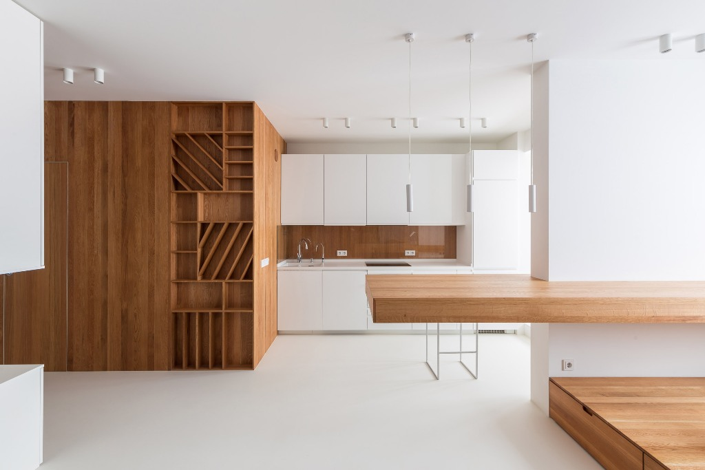 This ultra minimalist apartment is done of white and rich colored wood and features maximal functionality and the best organization of space