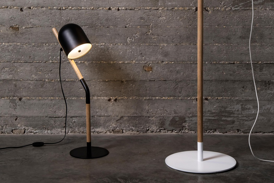 Union lamp collection includes floor and table lamps in black and white that can fit any modern space