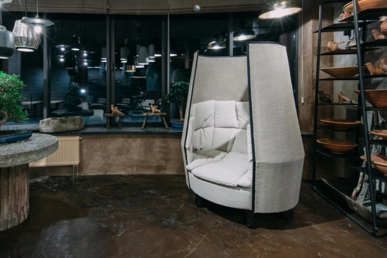 The chair features thick walls with padding for soundproofing and looks like a comfy cocoon