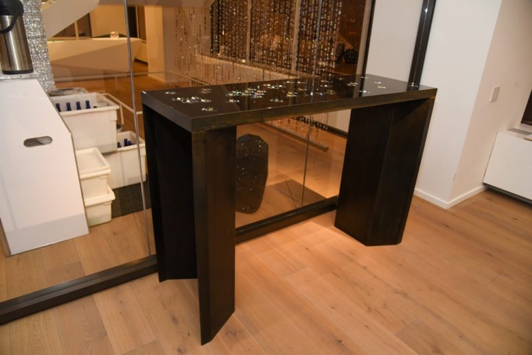 There's a stunning glam piece in dark brown wood and with crystals in the top, so don't place too many things on the table to enjoy the shine