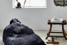02 a black chunky knit bean bag chair is a great one for a wabi-sabi space