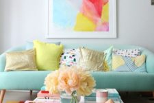 02 a mint sofa is a soft base for adding bright colors with the rug and the artwork for a cheerful feel