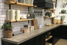 02 a rustic industrial kitchen with black cabinets and concrete countertops plus touches of light-colored wood
