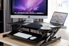 02 a small black height adjustable sit-stand desk with a keyboard tray for any office