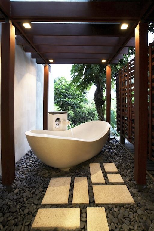 place your bathtub next to the house all and cover it with a wooden screne on the other side to feel comfy
