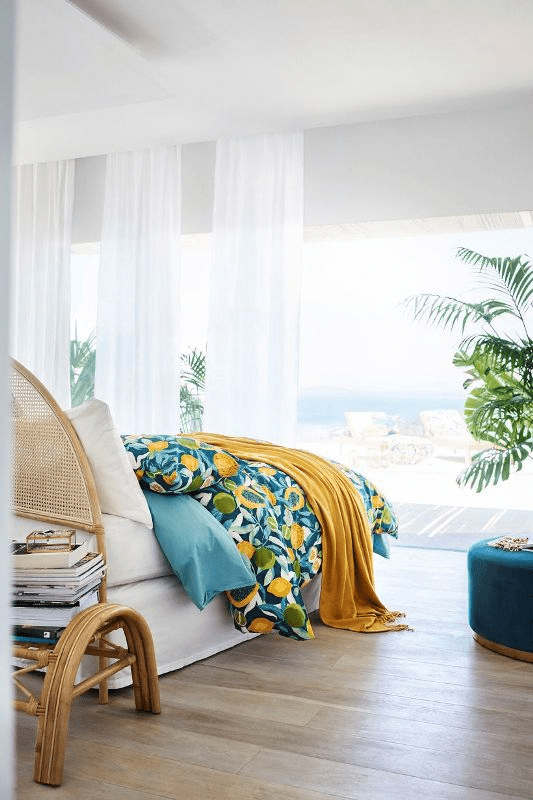 Dress up your bedroom with colorful tropical textiles to bring summer vibes