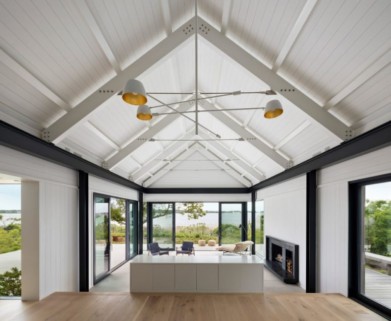The house features a gabled roof and lots of glazign to catch all the possible views