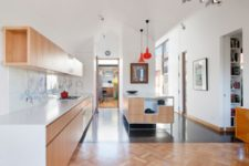 03 This is a kitchen and dining pavilion done with light-colored plywood and red touches