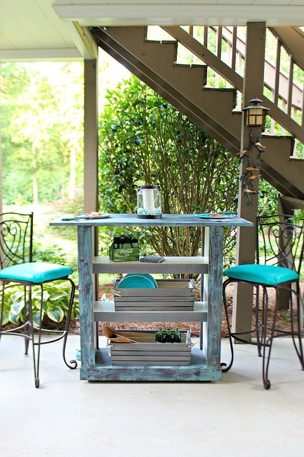 a Billy bookcase turned into a cool shabby chic outdoor bar painted in blue shades