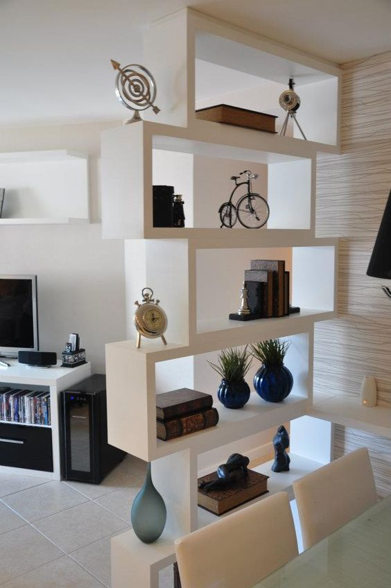 a contemporary white shelving unit makes the dining space visually separated