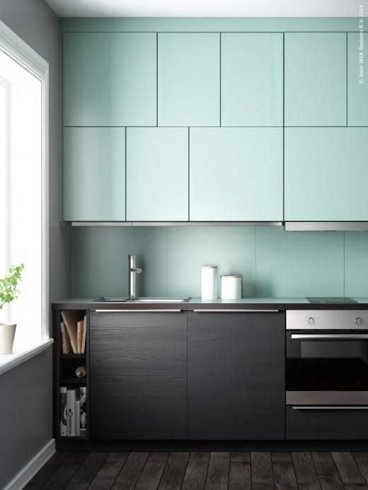 a minimalist kitchen in mint and very dark stained wood for a contrasting modern look