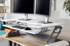 03 an adjustable metal and white plastic desk system is comfy piece to use if you don't want to change the whole desk